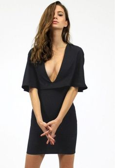 Bodycon cape dress. V-neck. Pull on style. Style #: L088-693 Material: Polyester Color: Black