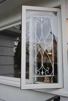 Add Uppercase Living vinyl to your windows. Love it! Very easy to apply and remove with no problems.
