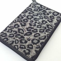 "Coach Ocelot Glitter Animal Print Signature Ereader Tablet Case Sleeve Cover F62906 New with Tag by Coach. $76.99. Color:  SV/Grey Multi Signature Coach Ocelot Leopard print in black, grey & silver Zipped closure Two interior pockets on left side  Right side has eReader section with elastic corner holders up to 5"" x 8""tablet size Compatible with Kindles, Kindle Fire, Nooks, Nook Color, Nook Tablet & the NEW iPad Mini! Measures approx. : 8.5""L x 5.75""H x 1""W"