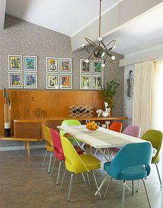 Mid-Century inspired dining room. I like the configuration of the framed prints on the wall - and everything else.