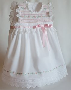 This beautiful Baby Girl Diaper Dress is perfect for welcoming house visits. The tri-dimensional flowers on the front center of - Salvabrani Smocked Baby Dresses, Little Girl Dresses, Girls Dresses, Sewing Patterns Girls, Dress Patterns, Baby Dress Design, Smocks, Frocks For Girls, Girls Party Dress