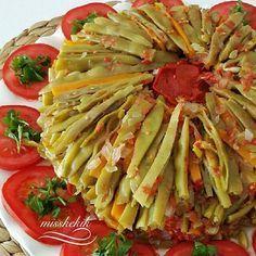 Malzemeler 1 kg taze fasulye 2 adet havuç 2 adet havuç 1 büyük boy soğan 3 orta boy domates 1/ 2 çay bardağı zeytinyağı 1 tatlı kaş...