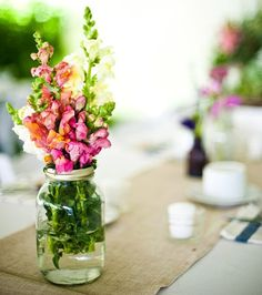 I love snapdragons! They're beautiful (and inexpensive!) and I think they could work in our wedding.