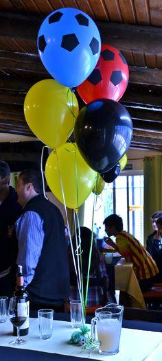 Centros de mesa, globos helio, fútbol.
