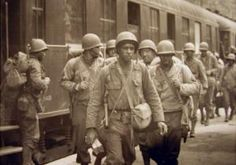 African-American troops arrive in Cherbourg, France in 1944 to aid in the Allied liberation of France.  Their contribution to the war effort, however, has been conspicuously missing from history and few medals were ever awarded to black soldiers.