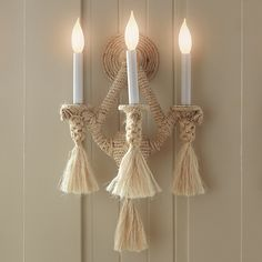 """Handcrafted with sisal rope on a steel frame. The rope sconce has 3 lights on candelabra bases. We recommend maximum 25 watt light bulbs. Dimensions 13"""" W x 10"""" D x 21"""" H"""
