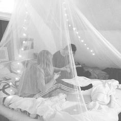 Veils and string lights over your bed-so romantic!
