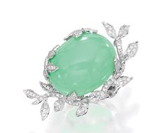 18 KARAT WHITE GOLD, GREEN OPAL AND DIAMOND RING, SIFEN CHANG.  The ring centered by a cabochon green opal weighing 33.36 carats, within foliate surrounds set with round diamonds weighing 1.05 carats, with Chinese characters for Sifen Chang