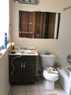 Our master bathroom is tiny. When we first bought our home 2 years ago, we quickly got tired of the cheap fixtures, cracked and broken tile, and little to no st…