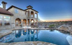 Concept Home: Located in Cordillera Ranch in Boerne TX.  7,300 sf of the ultimate in luxury living on 1.67 +/- acres and includes:  • Beautiful negative edge pool overlooking a ravine and Jack Nicklaus Signature Golf Course • Private putting green • State of the art electronic/audio/visual system • Elevator • Numerous water features • An extraordinary value at $2,495,000  For more information or to schedule a personal tour, please call Christine @ 830.980.4198. www.stadlercustomhomes.com
