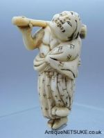 Ivory netsuke with with a washer figure. Good Kyoto school ivory netsuke with a figure standing with mop and bucket over shoulder, I like the way the kimono is off the working arm.  Size 50mm high- 42mm wide.  18th