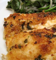 Lemon Broiled Flounder with Garlic Spinach 3 flounder filets 1 tablespoon lemon zest 2 tablespoons Old Bay seasoning 3 tablespoons mayonnaise 6 tablespoons panko breadcrumbs 6 tablespoons grated parmesan Nonstick cooking spray  For the Garlic Spinach: ½ lb fresh spinach ¼ thinly sliced white onion 2 sliced garlic cloves 2 tablespoons olive oil Salt, to taste