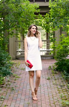 Nothing beats a little white dress in the summer and, though I've been leaning towards more flowy styles lately, there's something so classic & irresistible about a crisp eyelet shift.  Paired with strappy heels & a bright red lip, it's a timeless look for day or evening.  If you follow me on Snapchat (ppfgirl), you may have seen that I also wore this dress with a denim vest & white sneakers for a laid-back weekend vibe.  I love that it's fully lined and the contrasting lace trim detail…