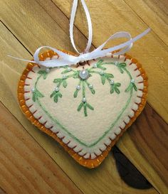 Wool Felt Embroidered Heart Ornament Hanger in by FHGoldDesigns Fabric Christmas Ornaments, Felt Christmas Decorations, Christmas Sewing, Noel Christmas, Felt Ornaments, Christmas Crafts, Xmas, Heart Ornament, Pumpkin Ornament