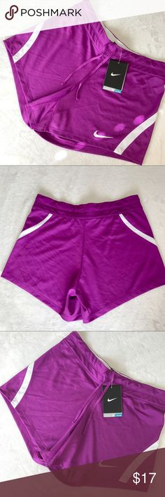 Nike Shorts Nike Shorts - NWT - Size XS - Pink/Purple color  - Draw string waist - Small mesh pocket inside back - White mesh details  Measurements: Inseam - 5 in. Waist - 29 in. + a little stretch Nike Shorts