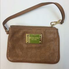 Michael Kors wristlet. Measures 6 inches x 4 inches.  Camel leather with MK design throughout.  2 pockets inside.  Excellent condition! Michael Kors Bags Clutches & Wristlets