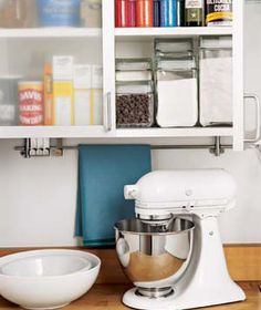 I love the idea of using the under cabinet space for a towel rod...