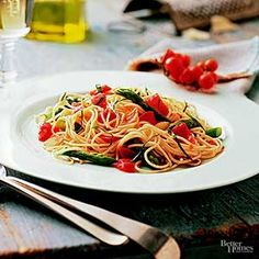 In 20 minutes, stir together fresh asparagus, tomatoes, refrigerated pasta, and basil for this one-dish dinner recipe.