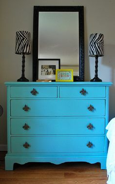 I'd use a little more of a pale blue and no zebra but I like the idea of using furniture to bring some color in