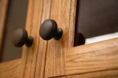 darker knobs on oak cabinet