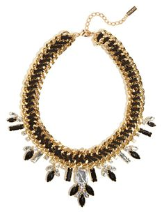 Dazzle them in this monochrome mixed media collar, crafted from onyx gems, crafty cord-work, and clear crystals, all set amongst a bevy of gold links.