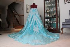 Wonderful and easy tutorial for the entire outfit! Note to self: FABRIC MOD PODGE -- http://rebari.wordpress.com/2014/02/02/elsa-from-disneys-frozen-costume-walkthrough-part-2-snowflakes-glitter/
