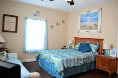 Master bedroom with queen bed and ceiling fan.  For more details, visit our Facebook page at https://www.facebook.com/barefootescapebeachrental/