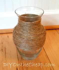 Wrap twine around a plain cheap vase to totally change the look.