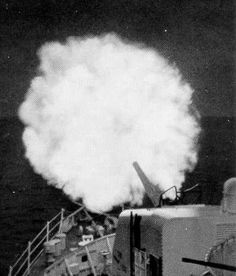 """USCG Night-firing the Minnetonka's 5-inch/38 on suspected Viet Cong positions, she fired a total of 4,684 5"""" rounds on the cruise.."""