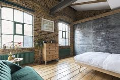 Bedroom in a penthouse with exposed brick in London