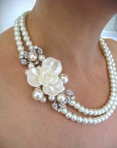 Gorgeous bridal necklace composed of swarovski pearls and rhinestone , perfect fits for the brides or any special occasion! The necklace long inner strand: 18 (45cm) The Flower measures approx. 2.1 x 3.2 (5.5cm x 8cm) Also available as a Hair Comb (ast photo) :