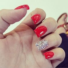 Red nails w/ studs in ring nail