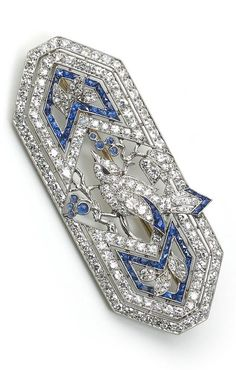 - An Art Deco sapphire and diamond bird brooch, circa Set with old cut and single cut diamonds, with calibre cut sapphire detail and cabochon cut sapphire eyes, mounted in platinum. Signed Marcus & Co. Heart Jewelry, Jewelry Art, Vintage Jewelry, Art Deco Artwork, Art Nouveau Jewelry, Gold Brooches, Art Deco Era, Art Deco Diamond, Diamond Cuts