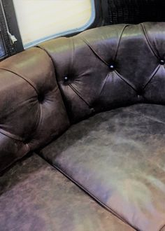 Here is a close up of the deep button leather upholstery hand crafted by our team for the Airstream trailer which is now the unique Land Yacht Bar.