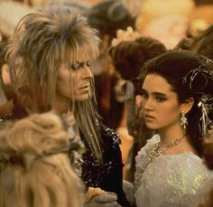 """bow-down-to-bowie: """"labyrinthnook: """" Jennifer Connelly looking somewhat uncomfortable as David Bowie looks imperious. """" Jennifer looks like that in most photos with Bowie. I think she felt really. David Bowie Labyrinth, Labyrinth Film, Jim Henson Labyrinth, Labyrinth Quotes, Goblin King, Jennifer Connelly, Sarah And Jareth, Labrynth, Fantasy Films"""