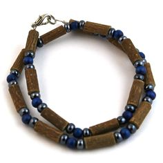 Hazelwood Blue & Hematite Necklace! Effective in reducing acid-based ailments and symptoms, such as eczema, acid-reflux, and heartburn, and ulcers. Must be placed directly on the skin and worn 24/7. Made with nylon-coated steel wire, hazelwood and assorted beads, and nickel clasp (lobster style opening).