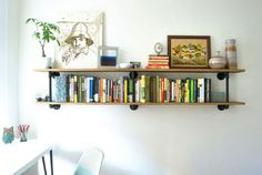 DIY: Plumbing pipe shelving, would make a great display for the shop