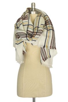 94bd6508eb71 This striking wraparound scarf is perfectly elegant and charming. Thanks to  a muted color palette