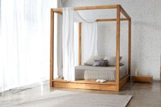 """PCH Canopy Bed by Mash StudiosSource: The Modern Shop Price: $5,324. 94"""" l. x 74"""" d. x 84"""" h. Made in the U.S.A. A stunning hybrid poster/platform bed in solid teak with a natural oil finish, with no visible hardware, has a Japanese purity."""