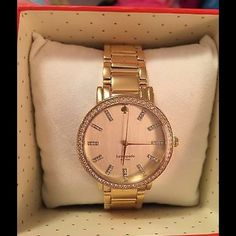 Kate Spade 1YRU0358 Gramercy Watch Authentic and brand New! Never worn with original box. Working battery. Gold-plated watch with crystals on bezel, spade at 12 o'lock, and crystal trio hour markers. Japanese quartz movement with analog display. Protective mineral crystal dial window. Features link bracelet and buckle closure. Not water resistant. Bought at Nordstom. Also, if you take watch to any Nordstrom, they will adjust the links for free! kate spade Accessories Watches