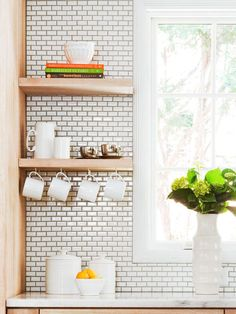 Storage Ideas for small Items:     Cups on Display  Take the strain of storage off the tops of your shelves and utilize the underside. Install cup hooks on the bottom of the shelf or cabinet and hang mugs on the hooks. Be sure to install the hooks far enough apart so that each mug has enough space to hang.