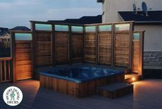 Nearly Solid lattuce hot tub privacy wall with accent lighting