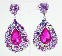 Fuchsia for pageant or prom! www.LMBling.com | fuchsia pageant earrings | fuchsia earrings | fuchsia prom earrings | pageant earrings | 3.25 inches long #lmbling #lmblingearrngs #lmblingredearrings #lmblingstatementearrings #pageantearrings #redpageantearrings #lmblingchandelierearrings #chunkyearrings #pageantjewelry #promjewelry