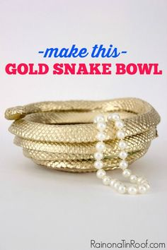Made with Dollar Tree Snakes & a Heat Gun! So pretty gold! DIY Gold Snake Bowl via RainonaTinRoof.com
