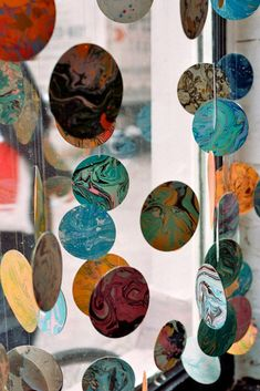 marbled paper discs make a celestial window display mobile/garland - photo by Anna Niestroj
