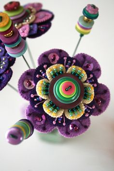 Button felt flowers with beads - how gorgeous.