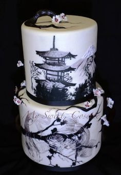 """ Pagoda Cherry Blossoms"" wedding cake ~All free hand work on the hand painted koi and pagoda scene, complemented by fondant branches and cherry blossoms ~ all edible"