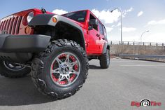 "2011 Jeep Wrangler with 4"" lift 18"" Moto Metal wheels 35"" Nitto Mud Grappler tires"