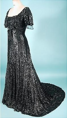 Matte Black Sequin Ballgown, c. 1907. I would totally wear this -- but first I'd remove those tassels from the front.