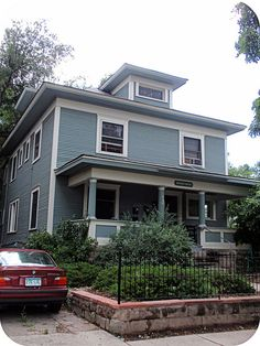 Muted Blue-green Foursquare house with off-white trim by eg2006, via Flickr